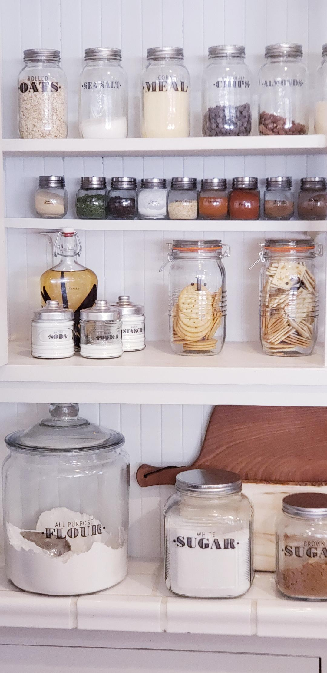 farmhouse pantry organized with clear jars and labels including baking items