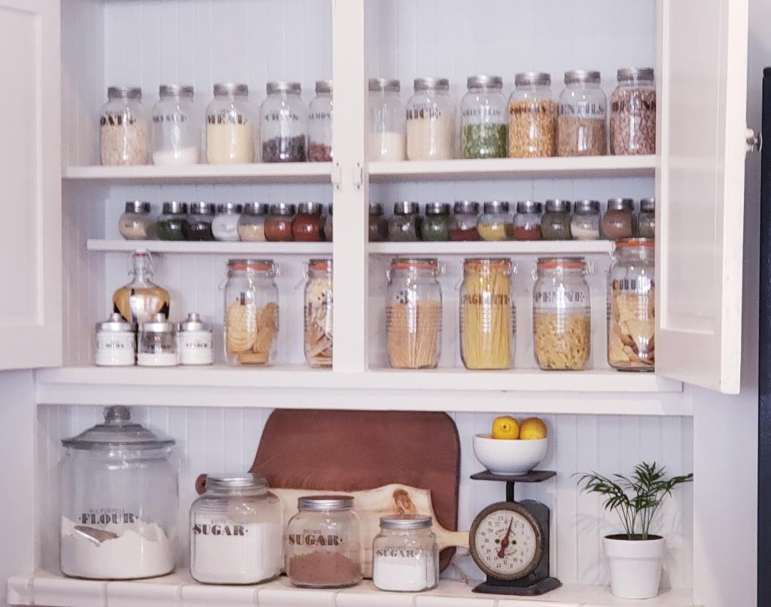 open door pantry with labeled jars