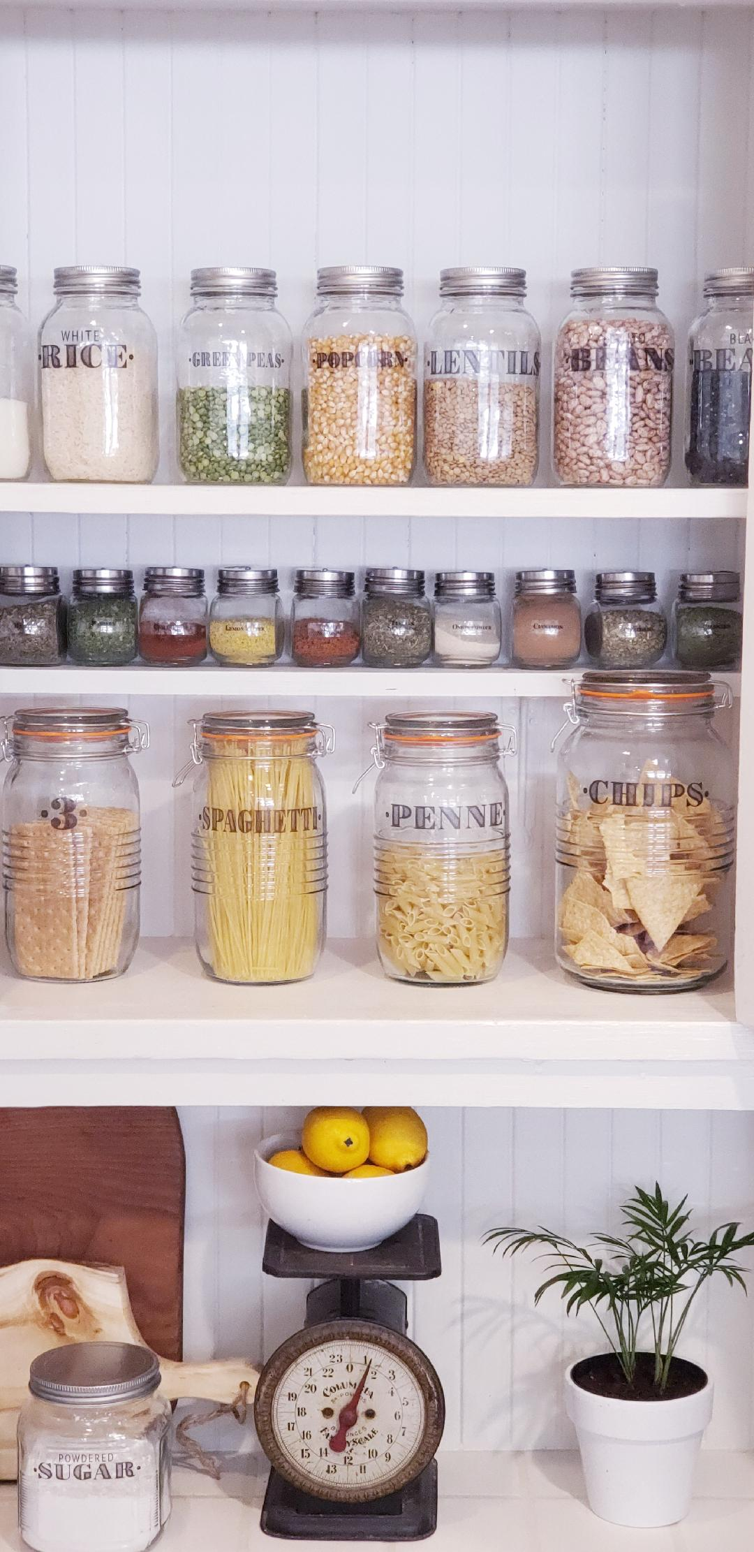 farmhouse pantry organized with clear jars and labels