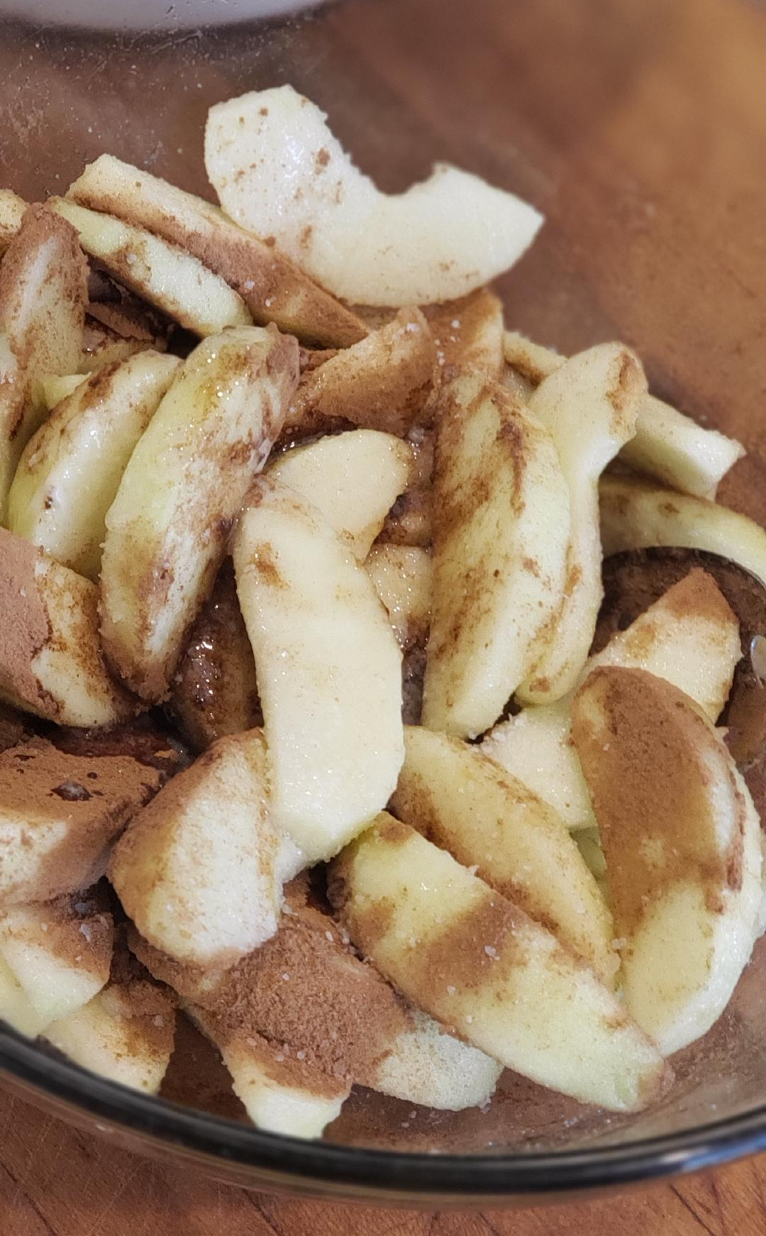 Cinnamon apple slices in bowl