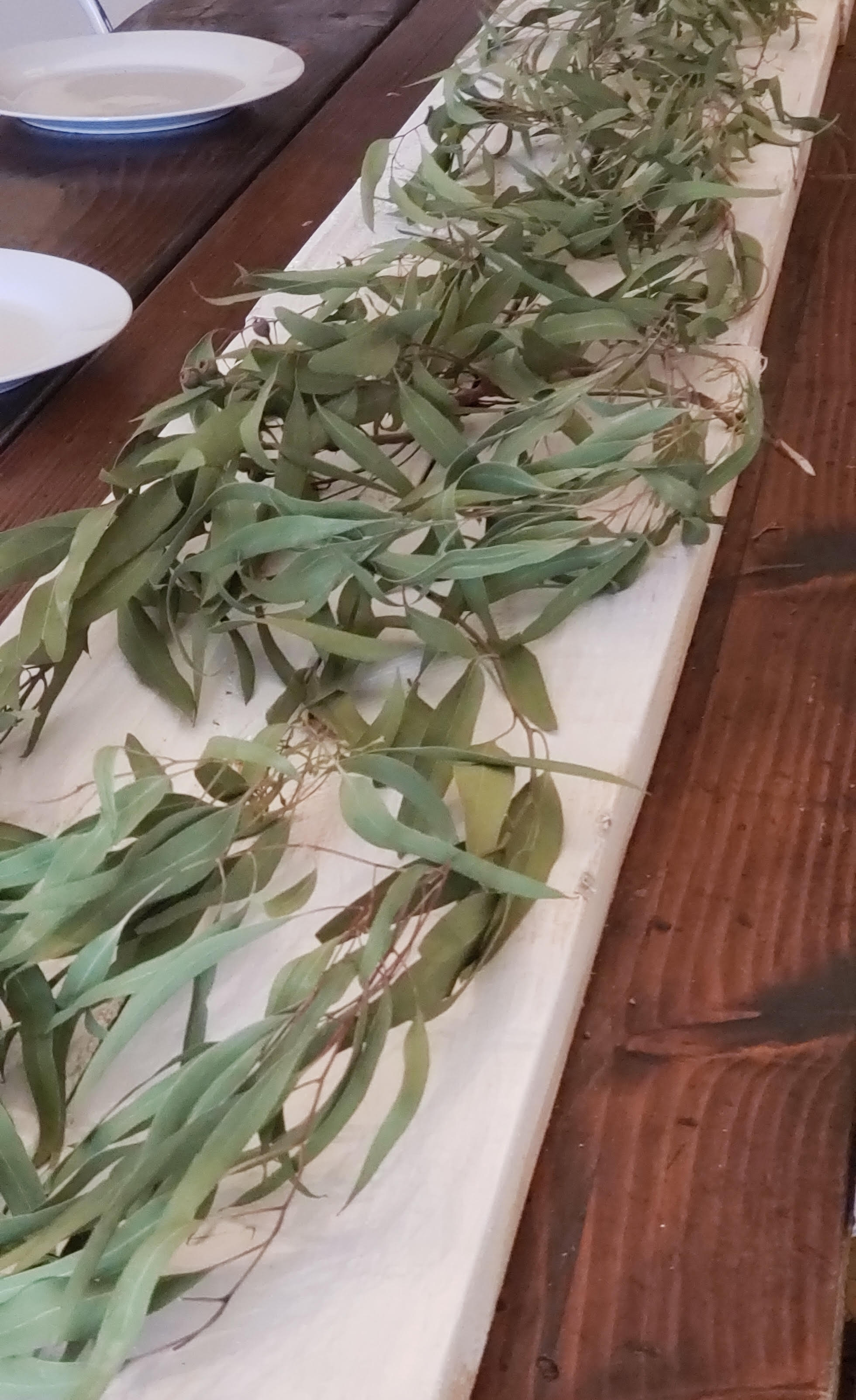eucalyptus as the center layer on tablescape